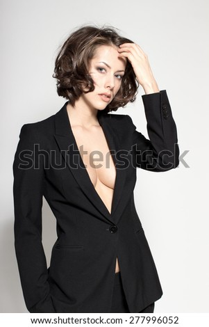 Portrait of gorgeous young caucasian attractive sexy business woman or secretary wearing black jacket - stock photo