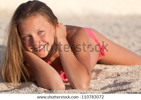 Portrait of gorgeous young girl  smiling while looking at you - stock photo