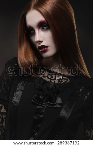 Portrait of gothic girl with black eyes in dark clothes - stock photo