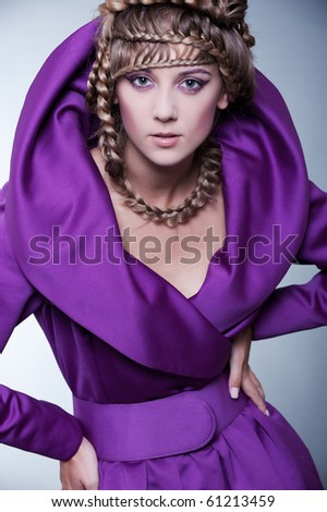 portrait of graceful woman in dress over grey background