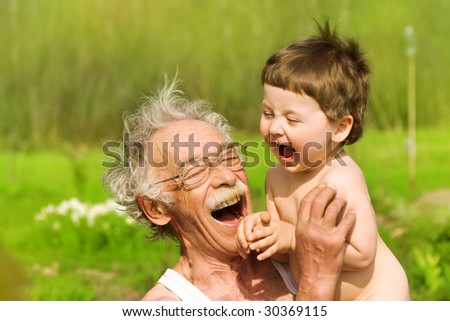 portrait of grandfather and grandson on nature background - stock photo