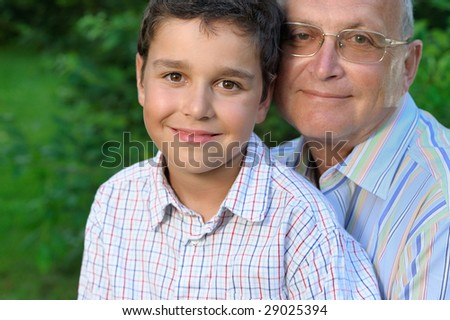 Portrait of grandfather and kid outdoors - stock photo