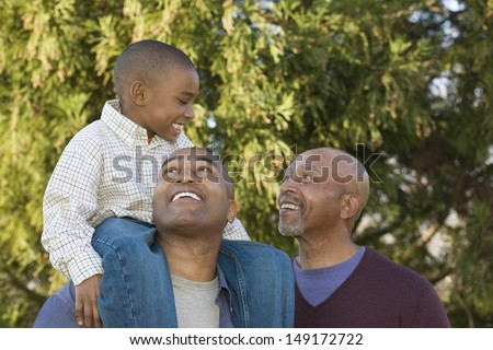 Portrait of grandfather, father and son - stock photo