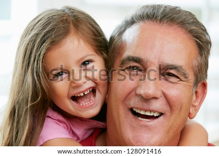 Portrait Of Grandfather With Granddaughter - stock photo