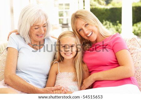 Portrait Of Grandmother, Daughter And Granddaughter Relaxing On Sofa