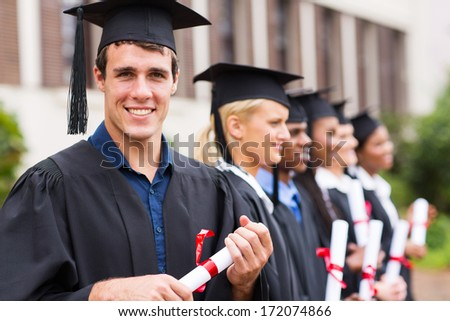 portrait of group cheerful college graduates at graduation - stock photo