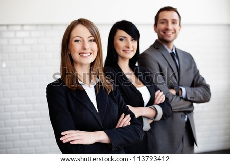 Portrait of group of business people smiling. Selective focus