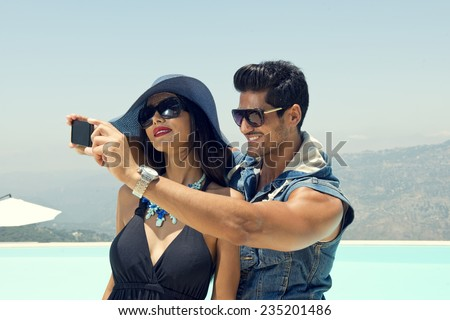 Portrait of group of friends taking photos with a smartphone, Couples taking Selfie - stock photo