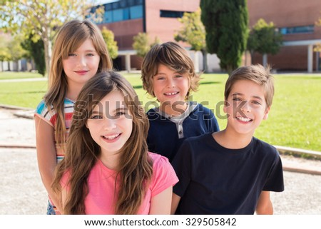 Portrait of group of kids on school campus - stock photo