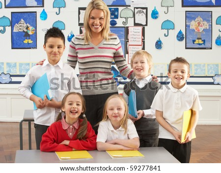 Portrait Of Group Of Primary Schoolchildren And Teacher Sitting At Desk In Classroom - stock photo