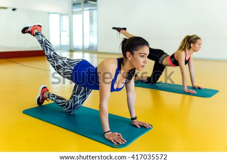 Portrait of group of sporty people doing aerobic class on a fitness center. - stock photo