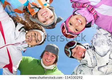 Portrait of Group of  teenagers have a good time in winter - stock photo
