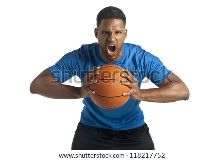 Portrait of guy screaming while holding a basketball ball against white background