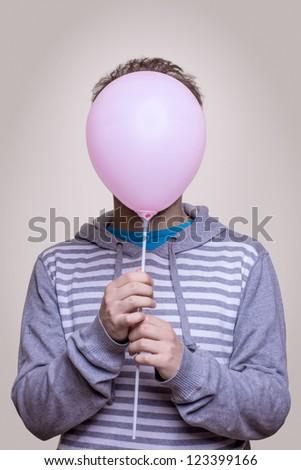 Portrait of guy with head - balloon - stock photo