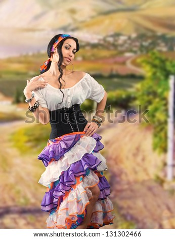 Portrait of Gypsy girl with Andalusian landscape - stock photo