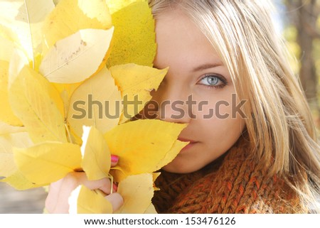 Portrait of half face beautiful blonde  teen girl - stock photo