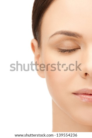 portrait of half face of beautiful woman - stock photo