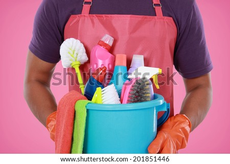 Portrait of hand with cleaning equipment ready to clean house - stock photo