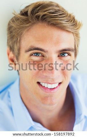 Portrait of Handsome Attractive Young Man Smiling