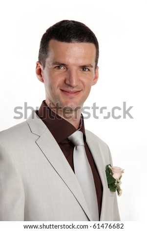 Portrait of handsome bridegroom isolated on white background