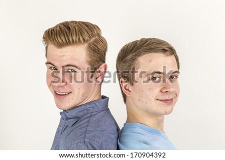portrait of handsome brothers posing in studio - stock photo