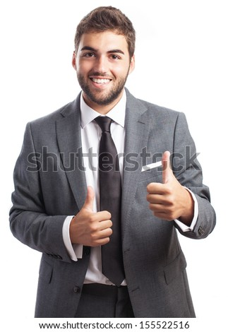 Portrait of handsome business man with thumb up isolated on white background