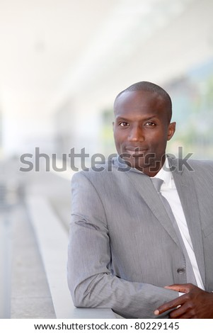 Portrait of handsome businessman wearing grey suit - stock photo