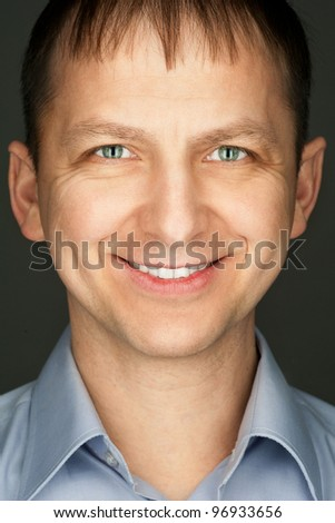 Portrait of handsome caucasian man looking at camera and smiling - stock photo