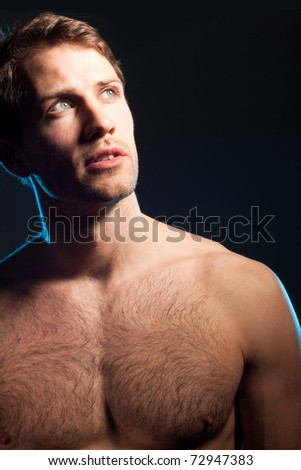 Portrait of handsome caucasian young man on black background