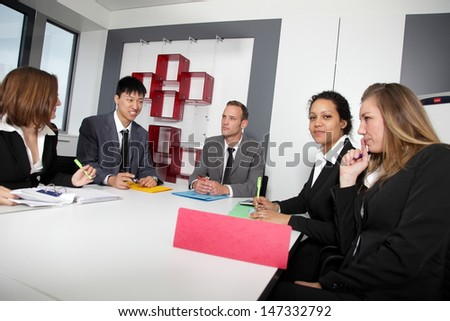 Portrait of handsome executive conversing with female associate in business meeting - stock photo