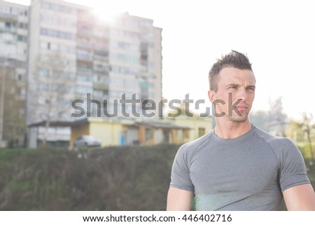portrait of handsome jogging man while relaxing and take break after morning run - stock photo