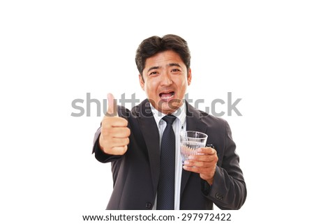 Portrait of handsome man drinking water