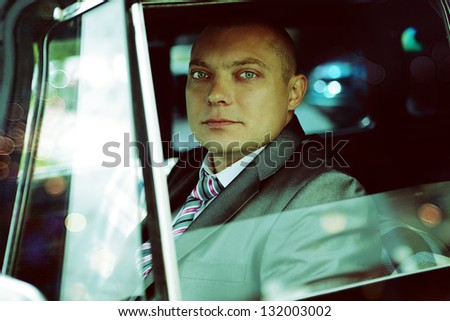 portrait of handsome man in a suit - stock photo
