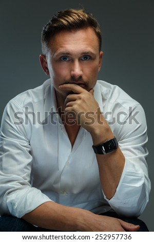 Portrait of handsome man in white shirt.