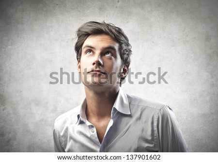 portrait of handsome man looking up - stock photo