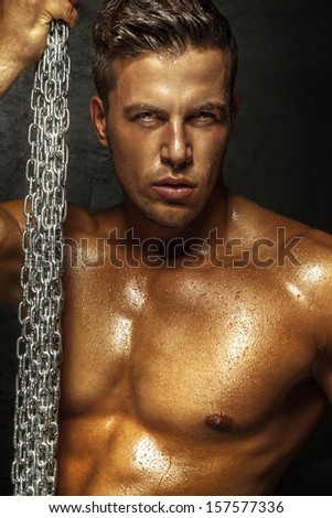 Portrait of handsome man posing, looking at camera - stock photo