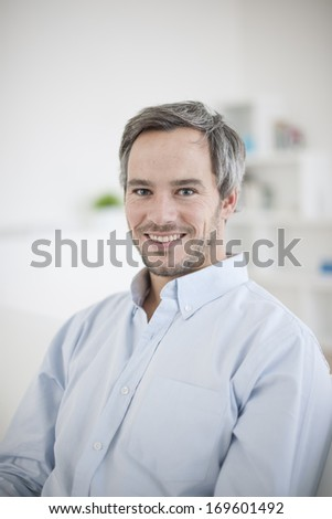 Portrait of handsome man relaxing at home - stock photo