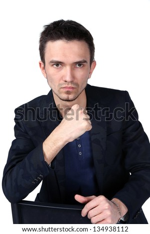 Portrait of handsome man sitting on white background.