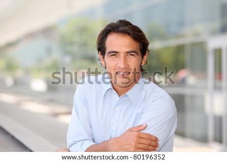 Portrait of handsome man standing outside - stock photo