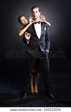 Portrait of handsome man  with beautiful woman near  at him