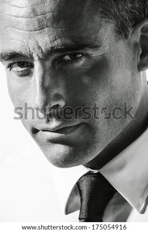 Portrait of handsome mature man. - stock photo