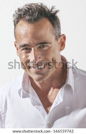 Portrait of handsome mature man. / Elegant smiling man portrait.  - stock photo
