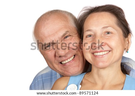 Portrait of handsome mature man hugging his wife from behind against white background - stock photo