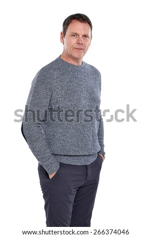 Portrait of handsome mature man posing confidently with his hands in pocket on white background  - stock photo