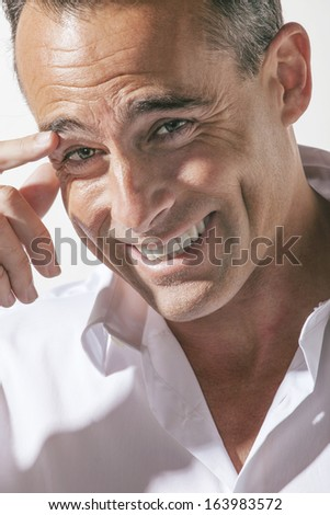 Portrait of handsome mature man smiling. - stock photo