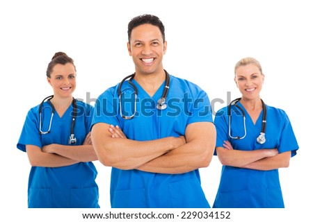 portrait of handsome mid age medical doctor with colleagues - stock photo
