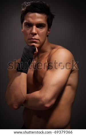 Portrait of handsome muscular man in thinking pose