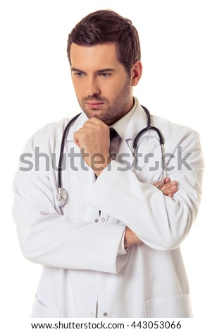 Portrait of handsome pensive doctor in white coat keeping hand on his chin and thinking, isolated on white background - stock photo