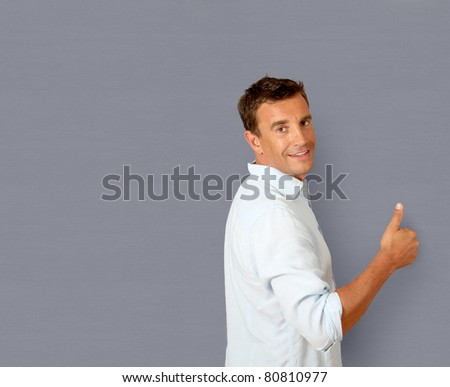 Portrait of handsome smiling man - stock photo