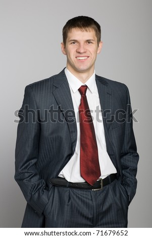Portrait of handsome smiling young businessman. - stock photo